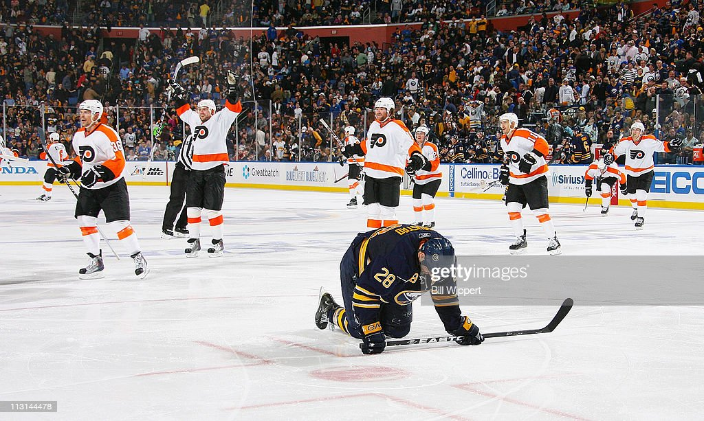 blue nhl jersey 9 canada paul gaustad 28 of the buffalo sabres reacts as the philadelphia flyers celebrate the game