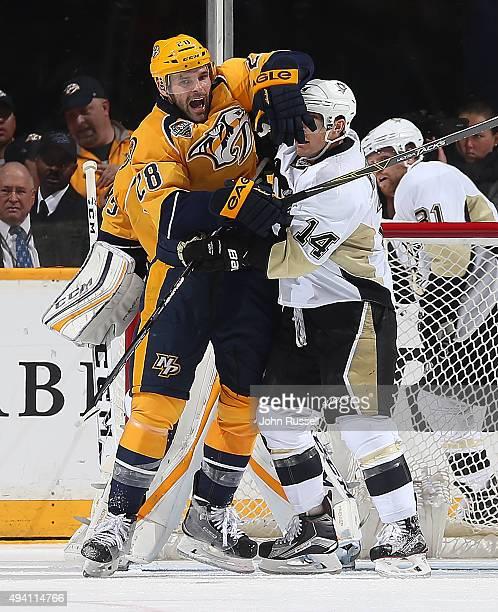 Paul Gaustad of the Nashville Predators battles against Chris Kunitz of the Pittsburgh Penguins during an NHL game at Bridgestone Arena on October 24...