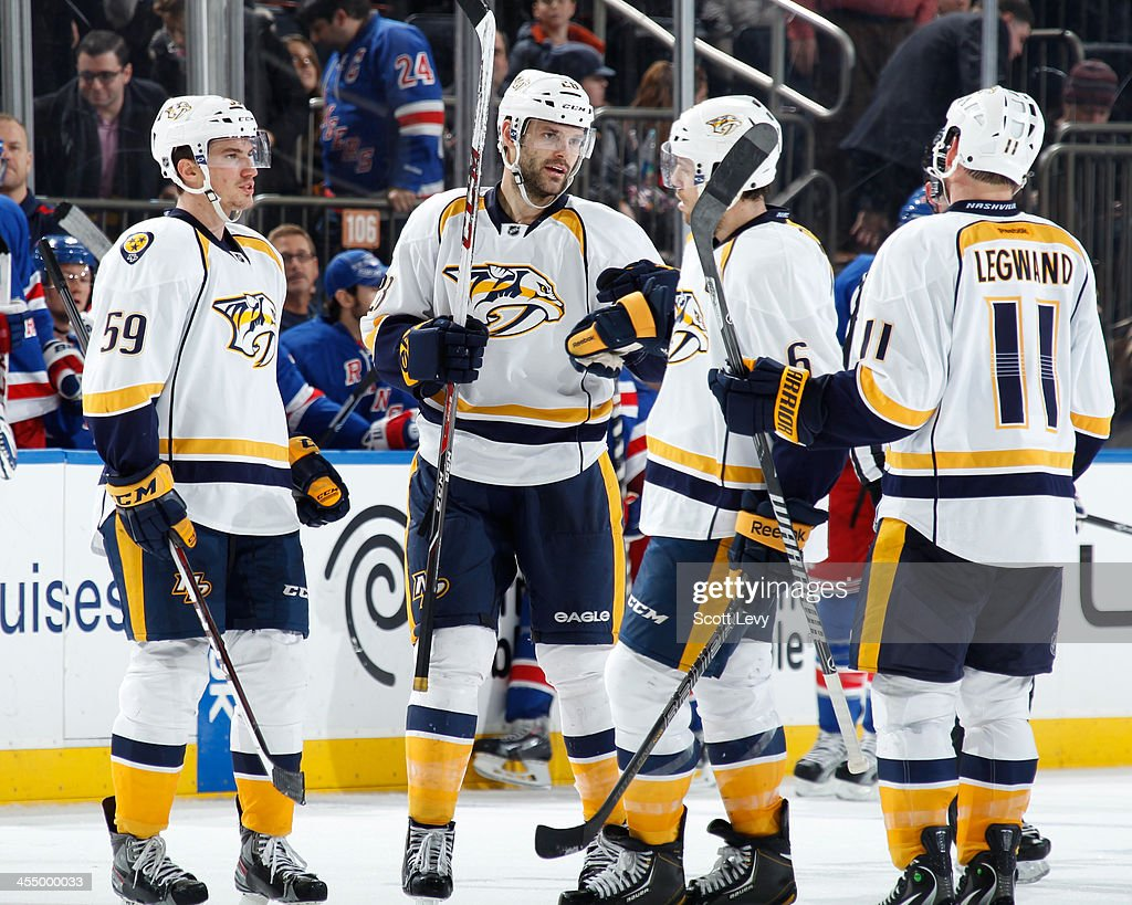 <a gi-track='captionPersonalityLinkClicked' href=/galleries/search?phrase=Paul+Gaustad&family=editorial&specificpeople=577980 ng-click='$event.stopPropagation()'>Paul Gaustad</a> #28 of the Nashville Predators celebrates an empty net goal against the New York Rangers at Madison Square Garden on December 10, 2013 in New York City.