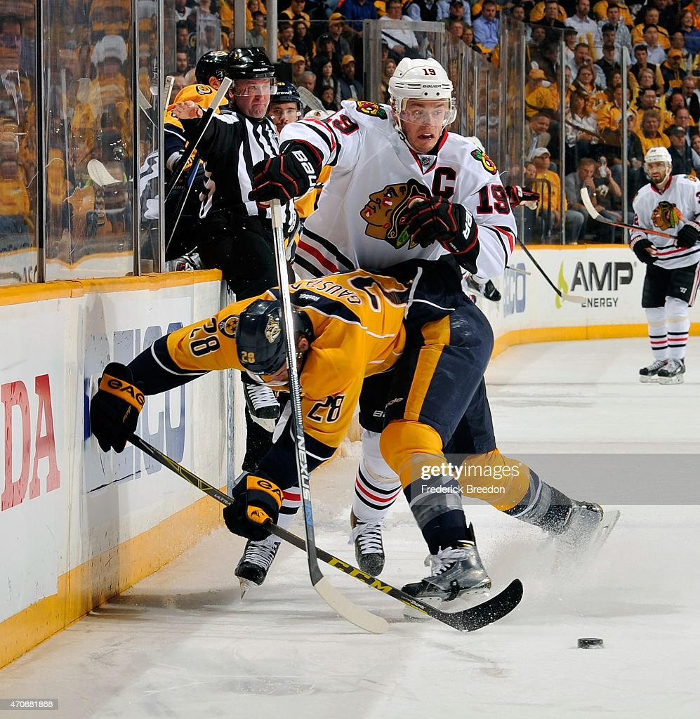Paul Gaustad #28 of the Nashville Predators collides with Jonathan Toews #19 of the Chicago Blackhawks during the first period of Game Five of the Western Conference Quarterfinals during the 2015 NHL Stanley Cup Playoffs at Bridgestone Arena on April 23, 2015 in Nashville, Tennessee.