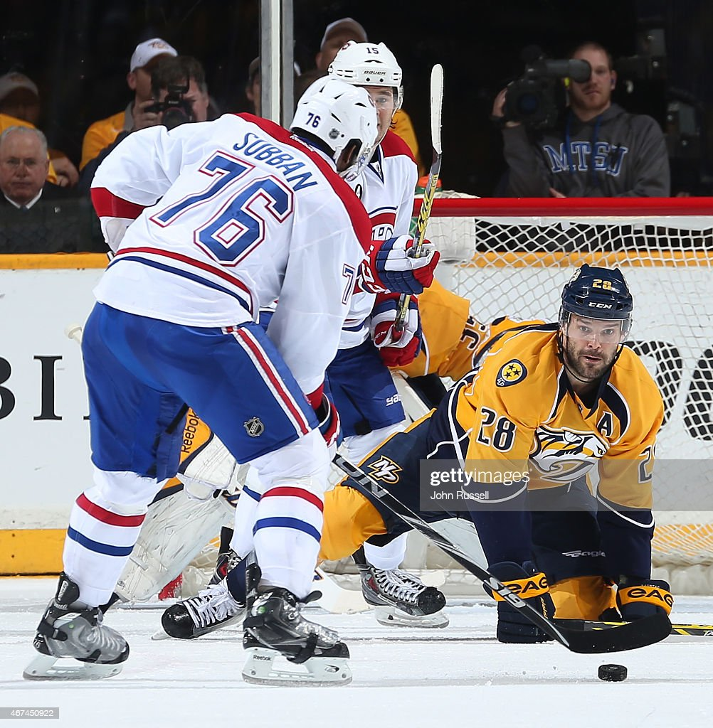Paul Gaustad #28 of the Nashville Predators eyes the puck on the stick of P.K. Subban #76 of the Montreal Canadiens during an NHL game at Bridgestone Arena on March 24, 2015 in Nashville, Tennessee.