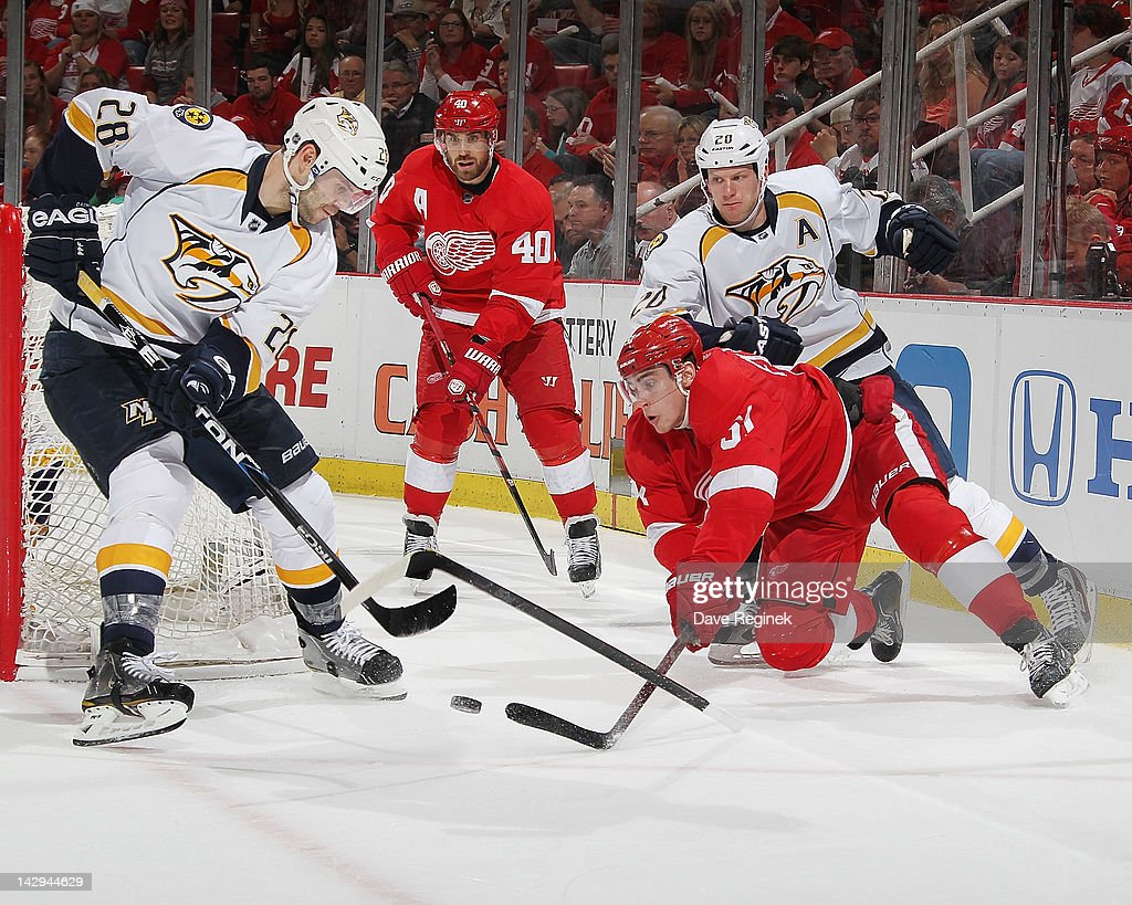 <a gi-track='captionPersonalityLinkClicked' href=/galleries/search?phrase=Paul+Gaustad&family=editorial&specificpeople=577980 ng-click='$event.stopPropagation()'>Paul Gaustad</a> #28 of the Nashville Predators fights for the puck with <a gi-track='captionPersonalityLinkClicked' href=/galleries/search?phrase=Valtteri+Filppula&family=editorial&specificpeople=2234404 ng-click='$event.stopPropagation()'>Valtteri Filppula</a> #51 of the Detroit Red Wings in Game Three of the Western Conference Quarterfinals during the 2012 NHL Stanley Cup Playoffs at Joe Louis Arena on April 15, 2012 in Detroit, Michigan. Nashville wins 3-2 leading the series 2-1.