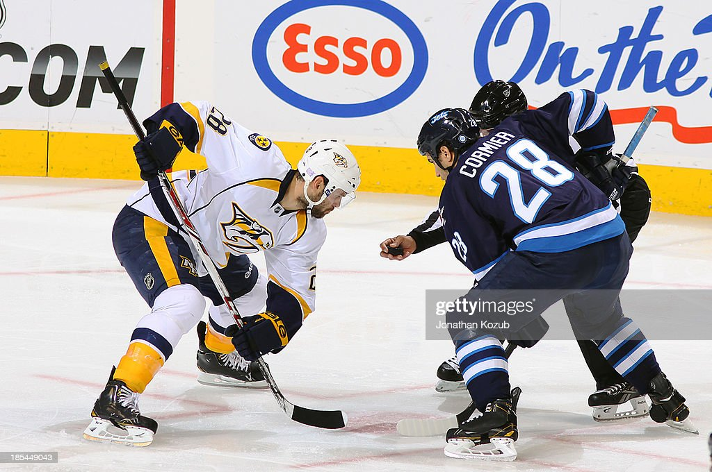 <a gi-track='captionPersonalityLinkClicked' href=/galleries/search?phrase=Paul+Gaustad&family=editorial&specificpeople=577980 ng-click='$event.stopPropagation()'>Paul Gaustad</a> #28 of the Nashville Predators gets set to take a second period face-off against <a gi-track='captionPersonalityLinkClicked' href=/galleries/search?phrase=Patrice+Cormier&family=editorial&specificpeople=4652958 ng-click='$event.stopPropagation()'>Patrice Cormier</a> #28 of the Winnipeg Jets at the MTS Centre on October 20, 2013 in Winnipeg, Manitoba, Canada.