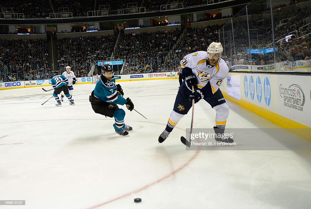 Paul Gaustad #28 of the Nashville Predators passes the puck against the San Jose Sharks at HP Pavilion on February 2, 2013 in San Jose, California.