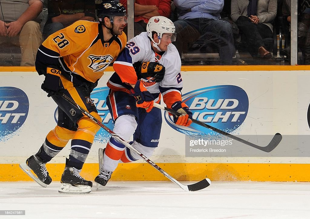 <a gi-track='captionPersonalityLinkClicked' href=/galleries/search?phrase=Paul+Gaustad&family=editorial&specificpeople=577980 ng-click='$event.stopPropagation()'>Paul Gaustad</a> #28 of the Nashville Predators skates against <a gi-track='captionPersonalityLinkClicked' href=/galleries/search?phrase=Brock+Nelson&family=editorial&specificpeople=7029374 ng-click='$event.stopPropagation()'>Brock Nelson</a> #29 of the New York Islanders at Bridgestone Arena on October 12, 2013 in Nashville, Tennessee.