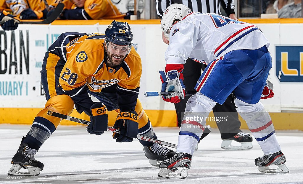 <a gi-track='captionPersonalityLinkClicked' href=/galleries/search?phrase=Paul+Gaustad&family=editorial&specificpeople=577980 ng-click='$event.stopPropagation()'>Paul Gaustad</a> #28 of the Nashville Predators smiles as he skates in for a face off against <a gi-track='captionPersonalityLinkClicked' href=/galleries/search?phrase=Daniel+Briere&family=editorial&specificpeople=201624 ng-click='$event.stopPropagation()'>Daniel Briere</a> #48 of the Montreal Canadiens at Bridgestone Arena on December 21, 2013 in Nashville, Tennessee.