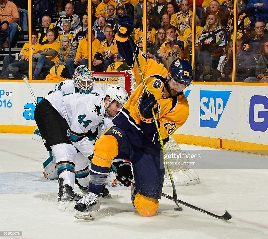 <a gi-track='captionPersonalityLinkClicked' href=/galleries/search?phrase=Paul+Gaustad&family=editorial&specificpeople=577980 ng-click='$event.stopPropagation()'>Paul Gaustad</a> #28 of the Nashville Predators tries to take a backhand shot from his knees against <a gi-track='captionPersonalityLinkClicked' href=/galleries/search?phrase=Marc-Edouard+Vlasic&family=editorial&specificpeople=880807 ng-click='$event.stopPropagation()'>Marc-Edouard Vlasic</a> #44 of the San Jose Sharks during the first period of Game Four of the Western Conference Second Round during the 2016 NHL Stanley Cup Playoffs at Bridgestone Arena on May 5, 2016 in Nashville, Tennessee.