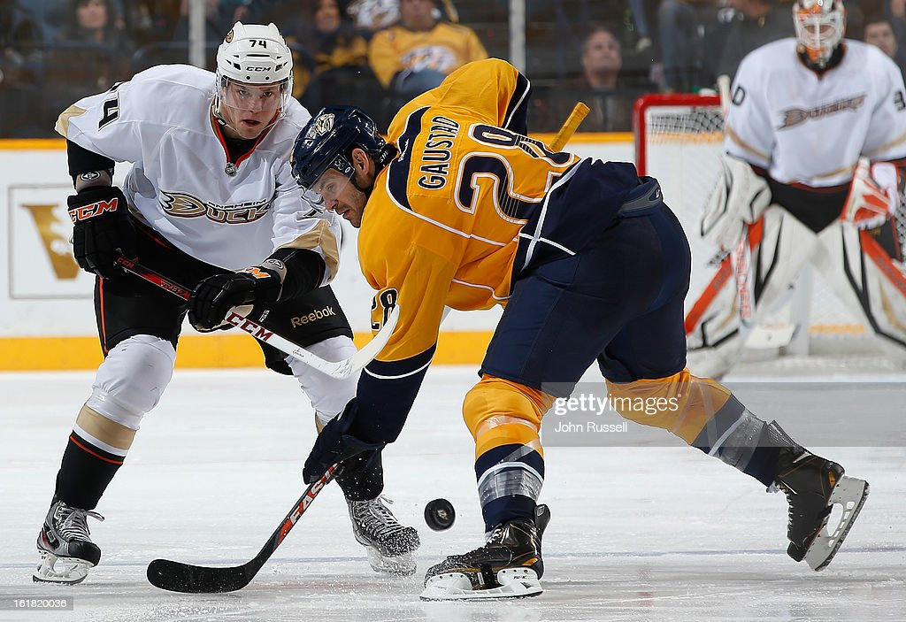 Paul Gaustad #28 of the Nashville Predators wins a faceoff against Peter Holland #74 of the Anaheim Ducks during an NHL game at the Bridgestone Arena on February 16, 2013 in Nashville, Tennessee.