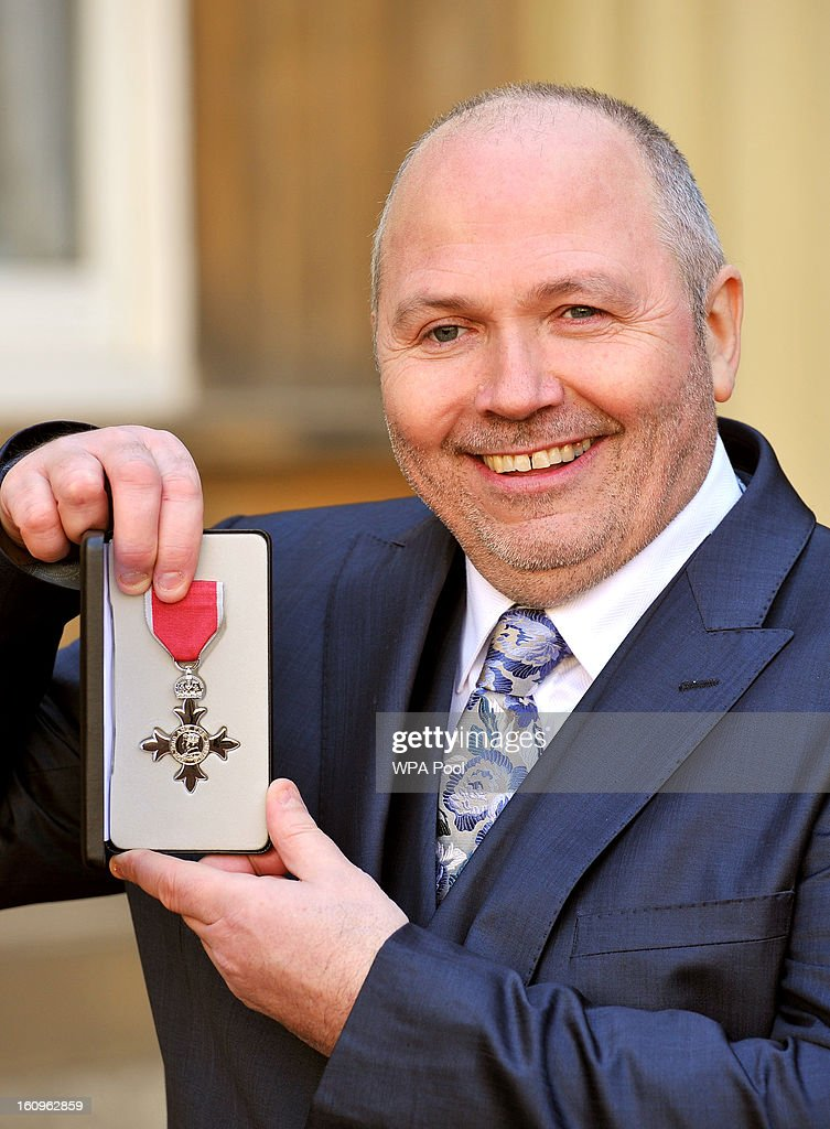 Paul Gayler the Chef of the Lainsborough Hotel in London, proudly holds his MBE (member of the British Empire), after it was presented to him by the Prince of Wales at an Investiture Ceremony, in Buckingham Palace on February 8, 2013 in London, England.