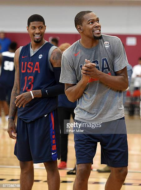 Paul George and Kevin Durant of the 2016 USA Basketball Men's National Team laugh on the court during a practice session at the Mendenhall Center on...