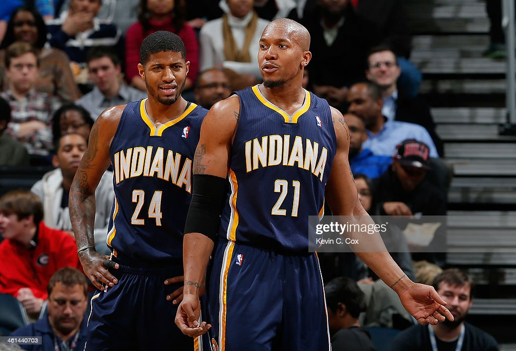 Paul George #24 and David West #21 of the Indiana Pacers react after a foul during the game against the Atlanta Hawks at Philips Arena on January 8, 2014 in Atlanta, Georgia.