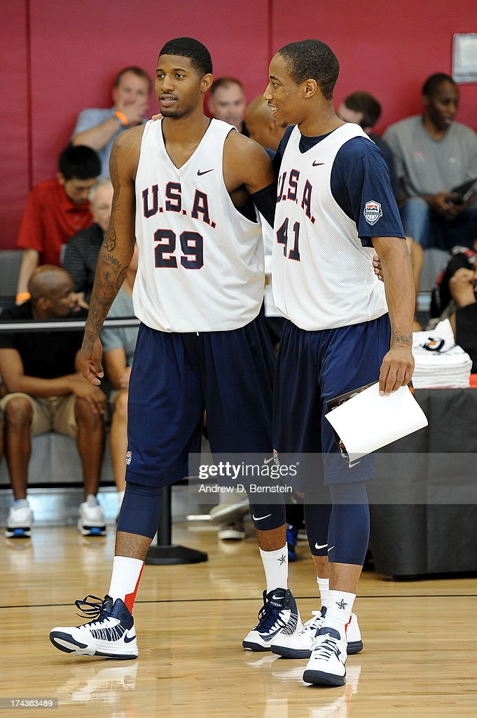 Paul George #29 and DeMar DeRozan #41 of the USA Basketball Men's National Team walk together during practice at Training Camp at the Mendenhall Center on July 24, 2013, in Las Vegas, Nevada.