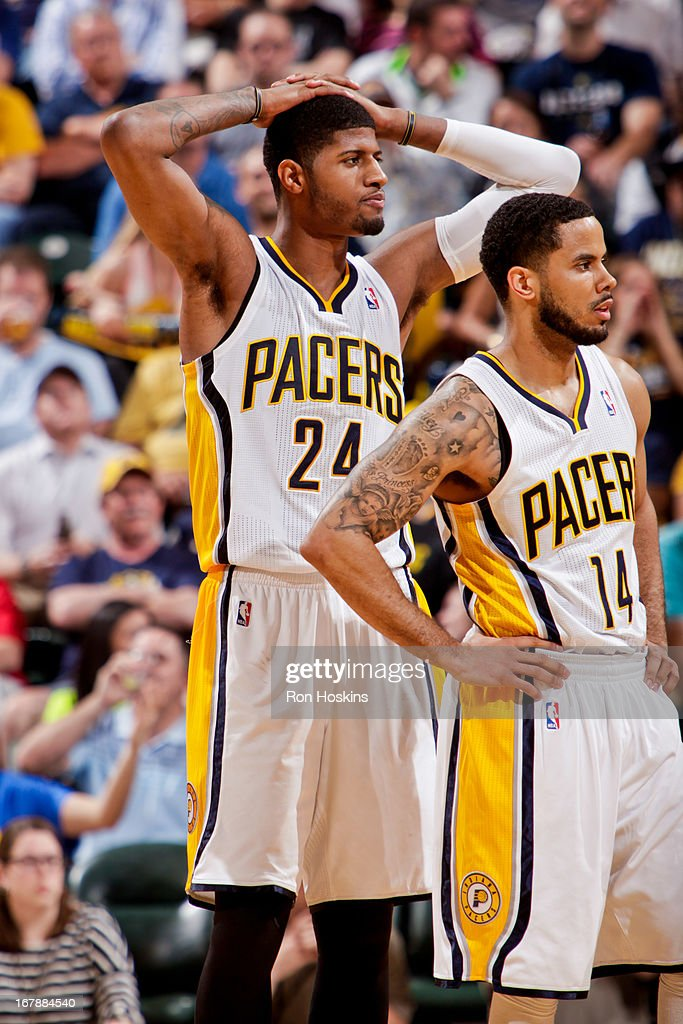 Paul George #24 and <a gi-track='captionPersonalityLinkClicked' href=/galleries/search?phrase=D.J.+Augustin&family=editorial&specificpeople=3847521 ng-click='$event.stopPropagation()'>D.J. Augustin</a> #14 of the Indiana Pacers react while playing the Atlanta Hawks in Game Five of the Eastern Conference Quarterfinals during the 2013 NBA Playoffs on May 1, 2013 at Bankers Life Fieldhouse in Indianapolis, Indiana.