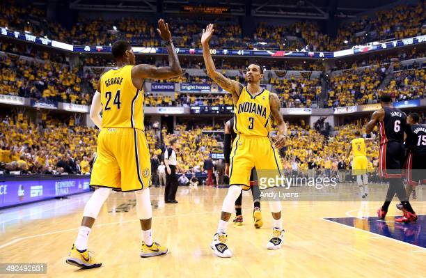 Paul George and George Hill of the Indiana Pacers celebrate against the Miami Heat during Game Two of the Eastern Conference Finals of the 2014 NBA...