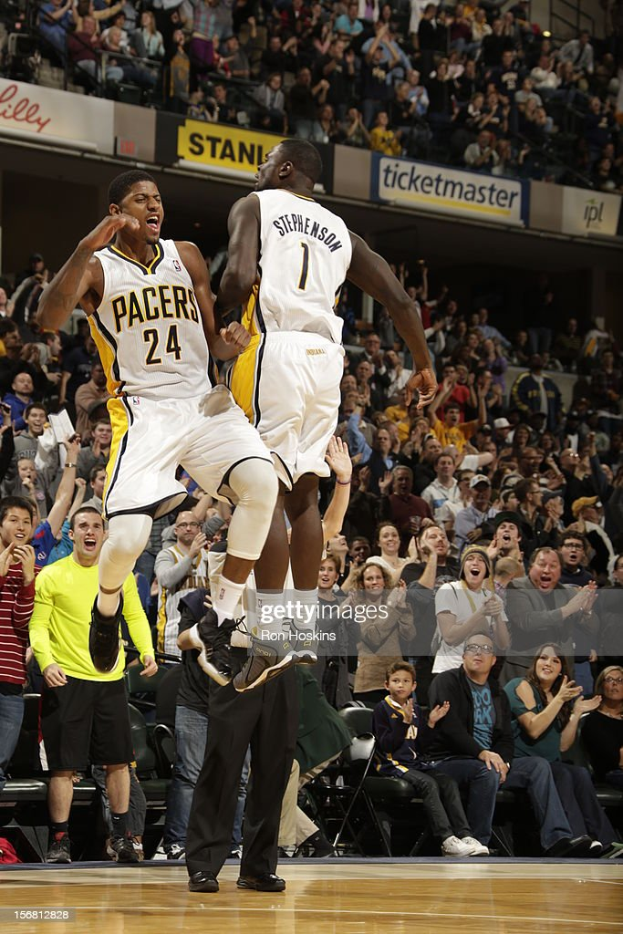 Paul George #24 and <a gi-track='captionPersonalityLinkClicked' href=/galleries/search?phrase=Lance+Stephenson&family=editorial&specificpeople=5298304 ng-click='$event.stopPropagation()'>Lance Stephenson</a> #1 of the Indiana Pacers chest bump during the game on November 21, 2012 at Bankers Life Fieldhouse in Indianapolis, Indiana.
