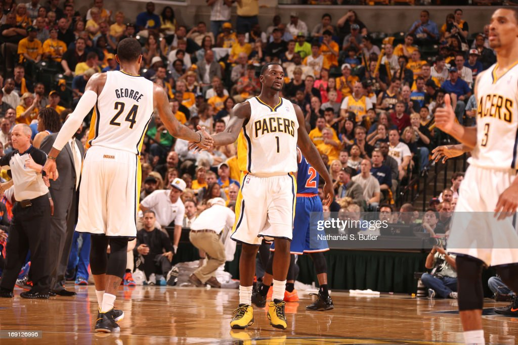 Paul George #24 and <a gi-track='captionPersonalityLinkClicked' href=/galleries/search?phrase=Lance+Stephenson&family=editorial&specificpeople=5298304 ng-click='$event.stopPropagation()'>Lance Stephenson</a> #1 of the Indiana Pacers congradulate each other in the game against the New York Knicks in Game Four of the Eastern Conference Semifinals during the 2013 NBA Playoffs on May 14, 2013 at Bankers Life Fieldhouse in Indianapolis.