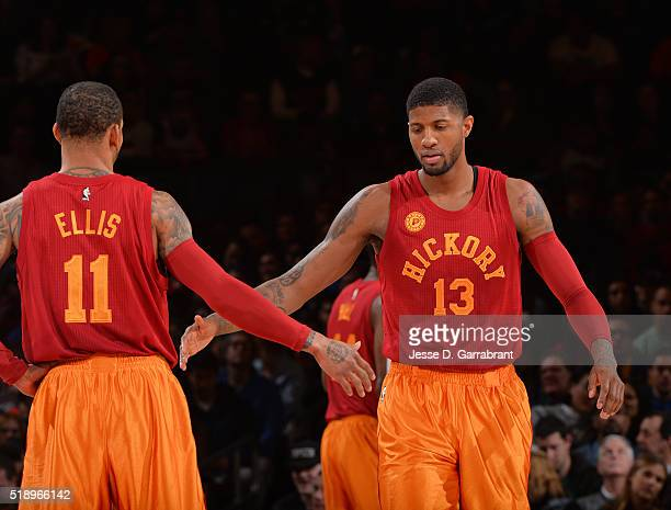 Paul George and Monta Ellis of the Indiana Pacers give each other fives against the New York Knicks at Madison Square Garden on April 3 2015 in New...
