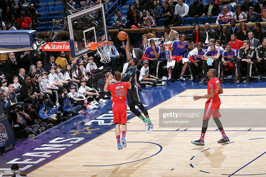 Paul George #24 of the Eastern Conference All-Stars dunks against <a gi-track='captionPersonalityLinkClicked' href=/galleries/search?phrase=Blake+Griffin+-+Basketball+Player&family=editorial&specificpeople=4216010 ng-click='$event.stopPropagation()'>Blake Griffin</a> #32 of the Western Conference All-Stars during the 2014 NBA All-Star Game at Smoothie King Center on February 16, 2014 in New Orleans, Louisiana.
