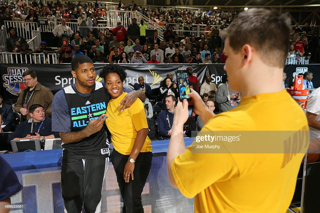 Paul George #24 of the Eastern Conference All-Stars takes a photo with a member of the military during the NBA All-Star Practices at Sprint Arena as part of 2014 NBA All-Star Weekend at the Ernest N. Morial Convention Center on February 15, 2014 in New Orleans, Louisiana.