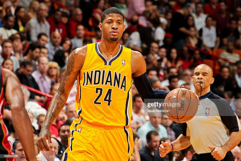 Paul George #24 of the Indiana Pacers advances the ball against the Miami Heat on March 10, 2013 at American Airlines Arena in Miami, Florida.