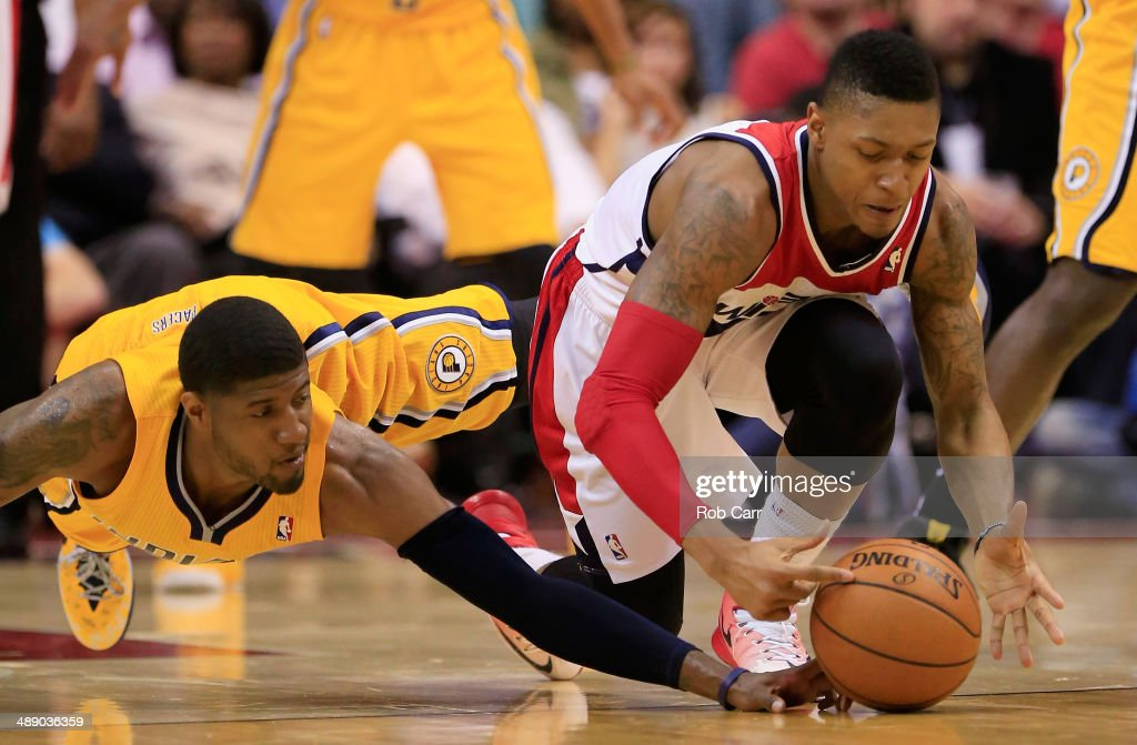 Paul George #24 of the Indiana Pacers and <a gi-track='captionPersonalityLinkClicked' href=/galleries/search?phrase=Bradley+Beal&family=editorial&specificpeople=7640439 ng-click='$event.stopPropagation()'>Bradley Beal</a> #3 of the Washington Wizards go after a loose ball during the first half of Game 3 of the Eastern Conference Semifinals during the 2014 NBA Playoffs at Verizon Center on May 9, 2014 in Washington, DC.