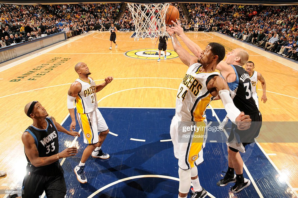 Paul George #24 of the Indiana Pacers and <a gi-track='captionPersonalityLinkClicked' href=/galleries/search?phrase=Greg+Stiemsma&family=editorial&specificpeople=2098297 ng-click='$event.stopPropagation()'>Greg Stiemsma</a> #34 of the Minnesota Timberwolves battle for the ball control during the game between the Indiana Pacers and the Minnesota Timberwolves on March 13, 2013 at Bankers Life Fieldhouse in Indianapolis, Indiana.