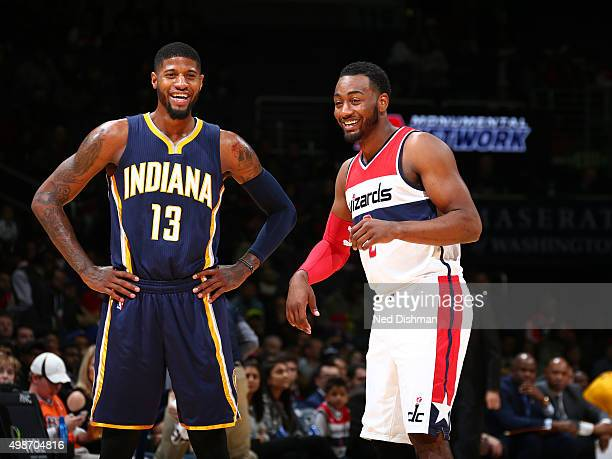 Paul George of the Indiana Pacers and John Wall of the Washington Wizards share a laugh during the game on November 24 2015 at Verizon Center in...