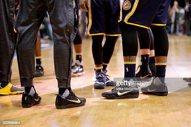 Paul George of the Indiana Pacers and Jordan Hill stand on the court during the third quarter in their NIKE signature Mamba shoes against the...