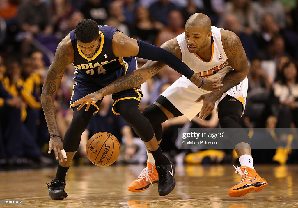 Paul George #24 of the Indiana Pacers and <a gi-track='captionPersonalityLinkClicked' href=/galleries/search?phrase=P.J.+Tucker&family=editorial&specificpeople=227316 ng-click='$event.stopPropagation()'>P.J. Tucker</a> #17 of the Phoenix Suns battle for a loose ball during the second half of the NBA game at US Airways Center on January 22, 2014 in Phoenix, Arizona. The Suns defeated the Pacers 124-100.