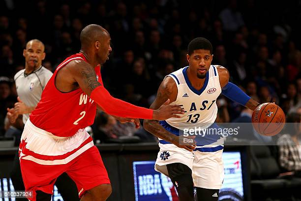 Paul George of the Indiana Pacers and the Eastern Conference handles the ball against Kobe Bryant of the Los Angeles Lakers and the Western...