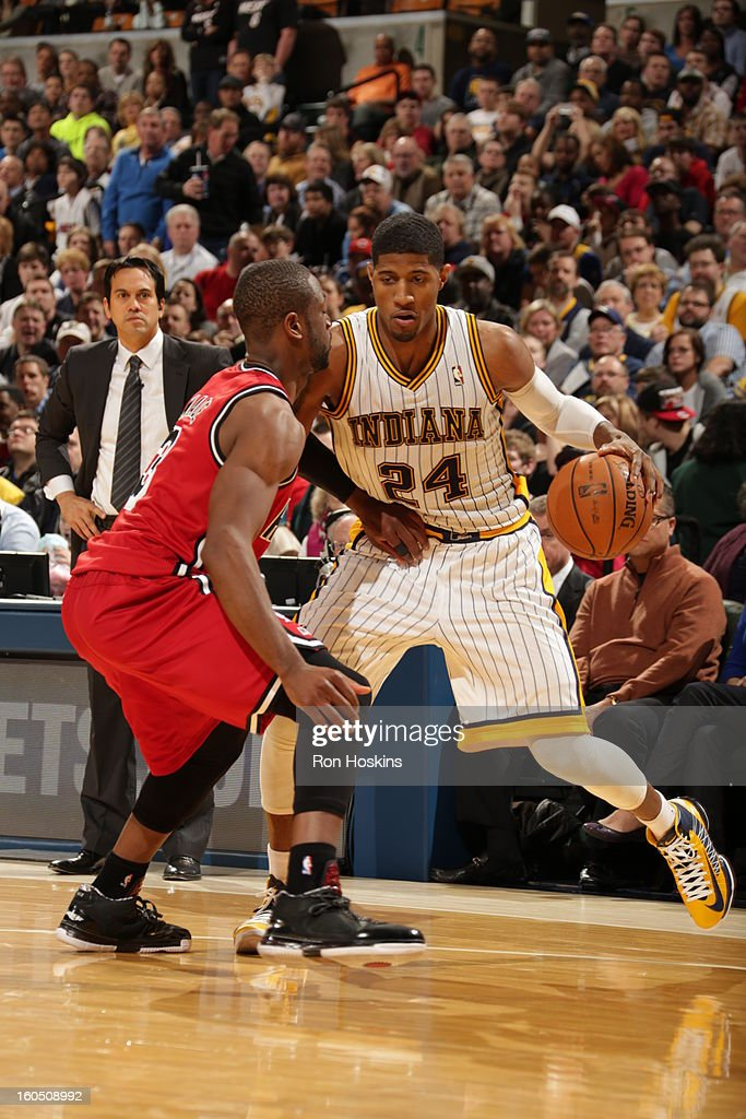 Paul George #24 of the Indiana Pacers attempts to dribble around the Miami Heat on February 1, 2013 at Bankers Life Fieldhouse in Indianapolis, Indiana.