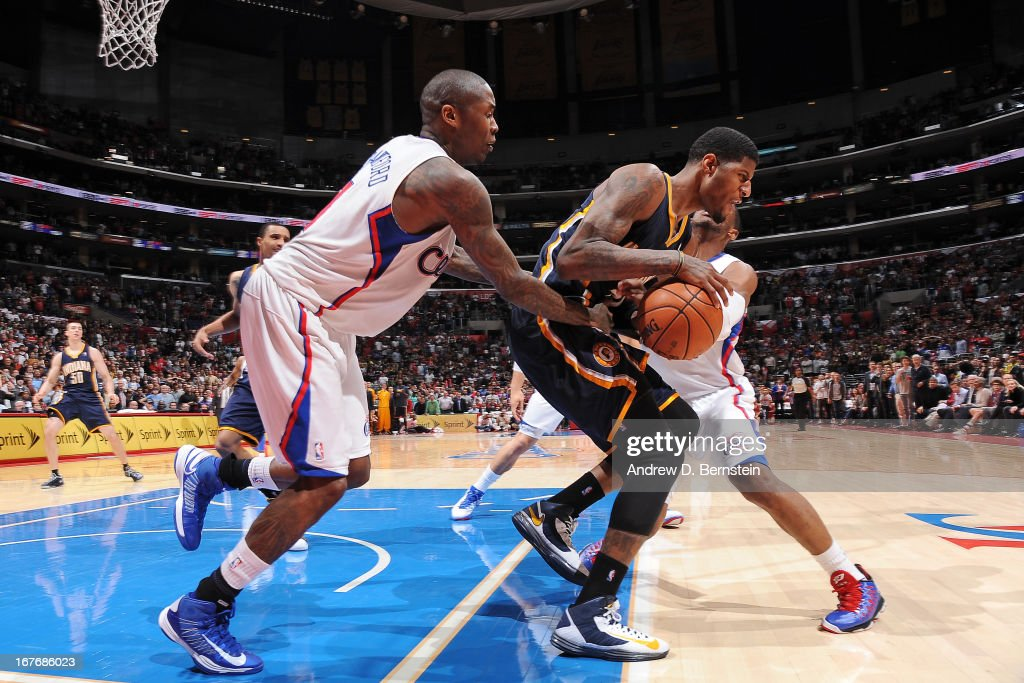 Paul George #24 of the Indiana Pacers battles for a loose ball against <a gi-track='captionPersonalityLinkClicked' href=/galleries/search?phrase=Jamal+Crawford&family=editorial&specificpeople=201851 ng-click='$event.stopPropagation()'>Jamal Crawford</a> #11 of the Los Angeles Clippers at Staples Center on April 1, 2013 in Los Angeles, California.