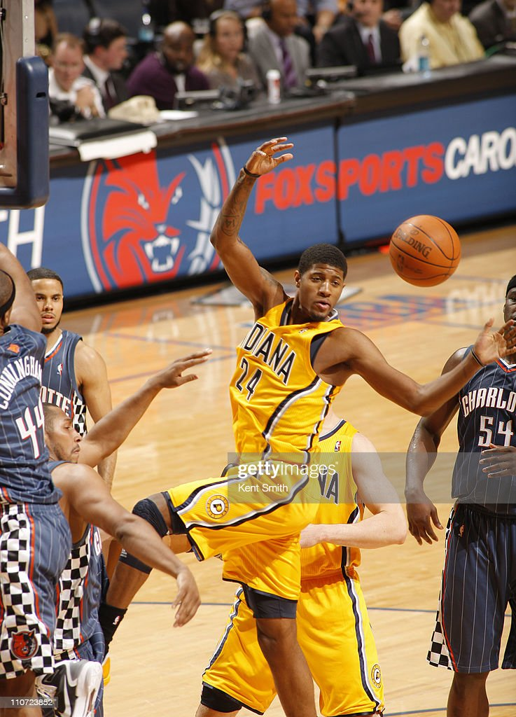 Paul George #24 of the Indiana Pacers battles for a rebound against the Charlotte Bobcats on March 23, 2011 at Time Warner Cable Arena in Charlotte, North Carolina.