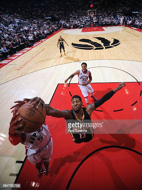 Paul George of the Indiana Pacers blocks a shot against the Toronto Raptors on October 28 2015 at the Air Canada Centre in Toronto Ontario Canada...