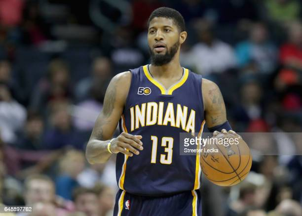 Paul George of the Indiana Pacers brings the ball up against the Charlotte Hornets during their game at Spectrum Center on March 6 2017 in Charlotte...