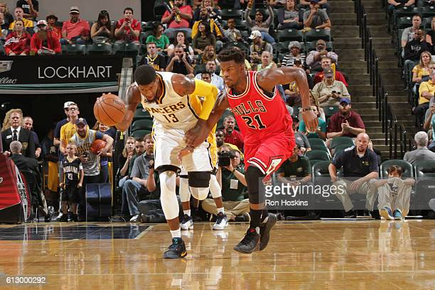 Paul George of the Indiana Pacers brings the ball up court against Jimmy Butler of the Chicago Bulls during a preseason game on October 6 2016 at...