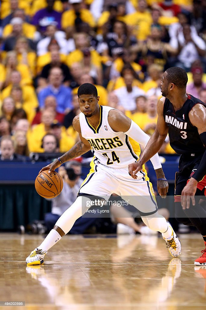 Paul George of the Indiana Pacers brings the ball up the floor as Dwyane Wade of the Miami Heat defends during Game Five of the Eastern Conference...