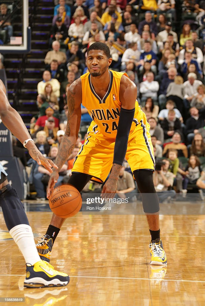 Paul George #24 of the Indiana Pacers brinsg the ball up court against the Memphis Grizzlies on December 31, 2012 at Bankers Life Fieldhouse in Indianapolis, Indiana.