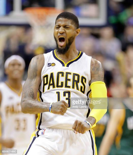 Paul George of the Indiana Pacers celebrates after making a shot against the Utah Jazz at Bankers Life Fieldhouse on March 20 2017 in Indianapolis...