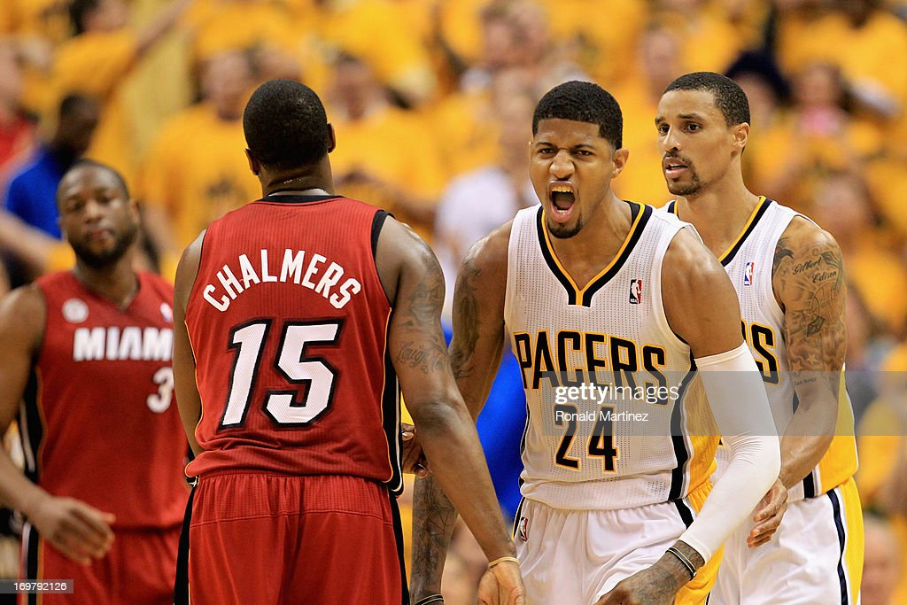 Paul George #24 of the Indiana Pacers celebrates against <a gi-track='captionPersonalityLinkClicked' href=/galleries/search?phrase=Mario+Chalmers&family=editorial&specificpeople=802115 ng-click='$event.stopPropagation()'>Mario Chalmers</a> #15 of the Miami Heat in Game Six of the Eastern Conference Finals during the 2013 NBA Playoffs at Bankers Life Fieldhouse on June 1, 2013 in Indianapolis, Indiana.