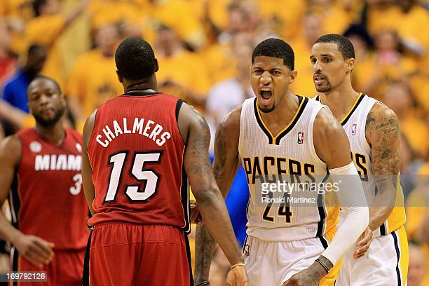 Paul George of the Indiana Pacers celebrates against Mario Chalmers of the Miami Heat in Game Six of the Eastern Conference Finals during the 2013...