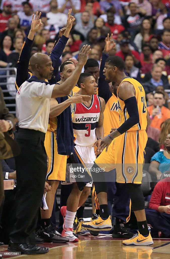 Paul George #24 of the Indiana Pacers celebrates in front of <a gi-track='captionPersonalityLinkClicked' href=/galleries/search?phrase=Bradley+Beal&family=editorial&specificpeople=7640439 ng-click='$event.stopPropagation()'>Bradley Beal</a> #3 of the Washington Wizards after hitting a three pointer during the second half of Game 3 of the Eastern Conference Semifinals during the 2014 NBA Playoffs at Verizon Center on May 9, 2014 in Washington, DC. The Pacers won 85-63.