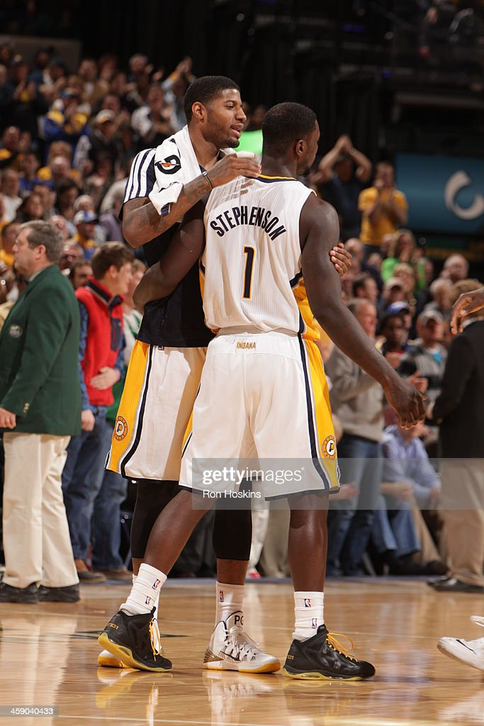 Paul George #24 of the Indiana Pacers celebrates with teammate Lance Stephenson #1 during the game against the Boston Celtics on December 22, 2013 in Indianapolis, Indiana at Bankers Life Fieldhouse.