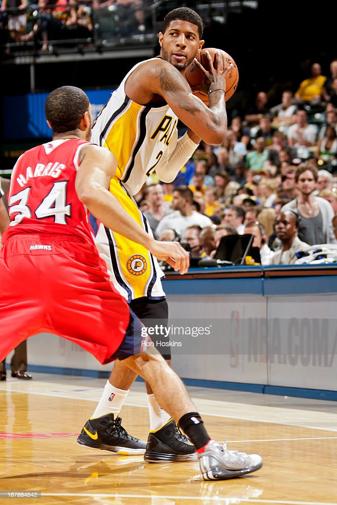 Paul George #24 of the Indiana Pacers controls the ball against <a gi-track='captionPersonalityLinkClicked' href=/galleries/search?phrase=Devin+Harris&family=editorial&specificpeople=202195 ng-click='$event.stopPropagation()'>Devin Harris</a> #34 of the Atlanta Hawks in Game Five of the Eastern Conference Quarterfinals during the 2013 NBA Playoffs on May 1, 2013 at Bankers Life Fieldhouse in Indianapolis, Indiana.