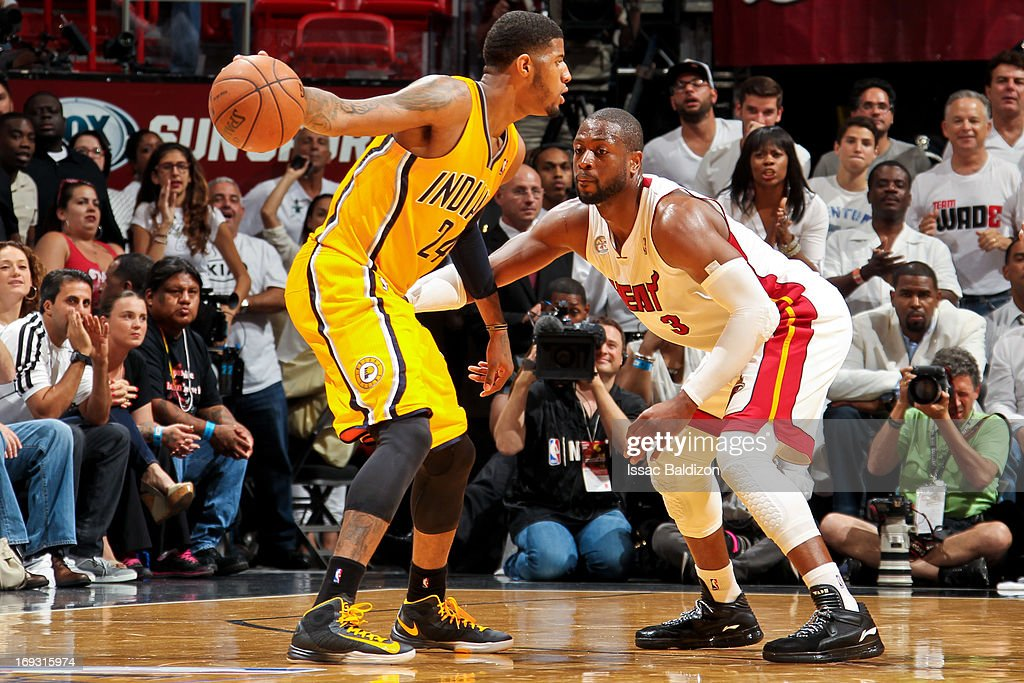 Paul George #24 of the Indiana Pacers controls the ball against Dwyane Wade #3 of the Miami Heat in Game One of the Eastern Conference Finals during the 2013 NBA Playoffs on May 22, 2013 at American Airlines Arena in Miami, Florida.