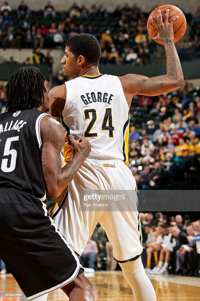 Paul George #24 of the Indiana Pacers controls the ball against Gerald Wallace #45 of the Brooklyn Nets on February 11, 2013 at Bankers Life Fieldhouse in Indianapolis, Indiana.