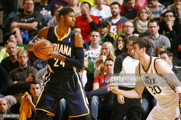 Paul George of the Indiana Pacers controls the ball against Gordon Hayward of the Utah Jazz at EnergySolutions Arena on December 04 2013 in Salt Lake...