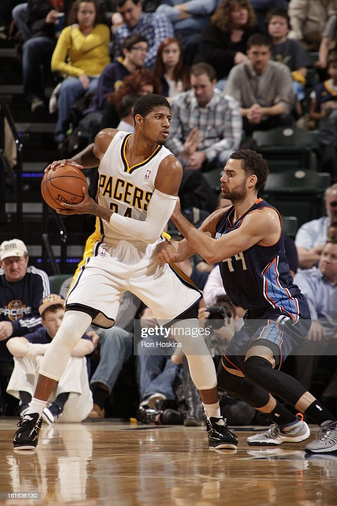 Paul George #24 of the Indiana Pacers controls the ball against Jeffery Taylor #44 of the Charlotte Bobcats on February 13, 2013 at Bankers Life Fieldhouse in Indianapolis, Indiana.