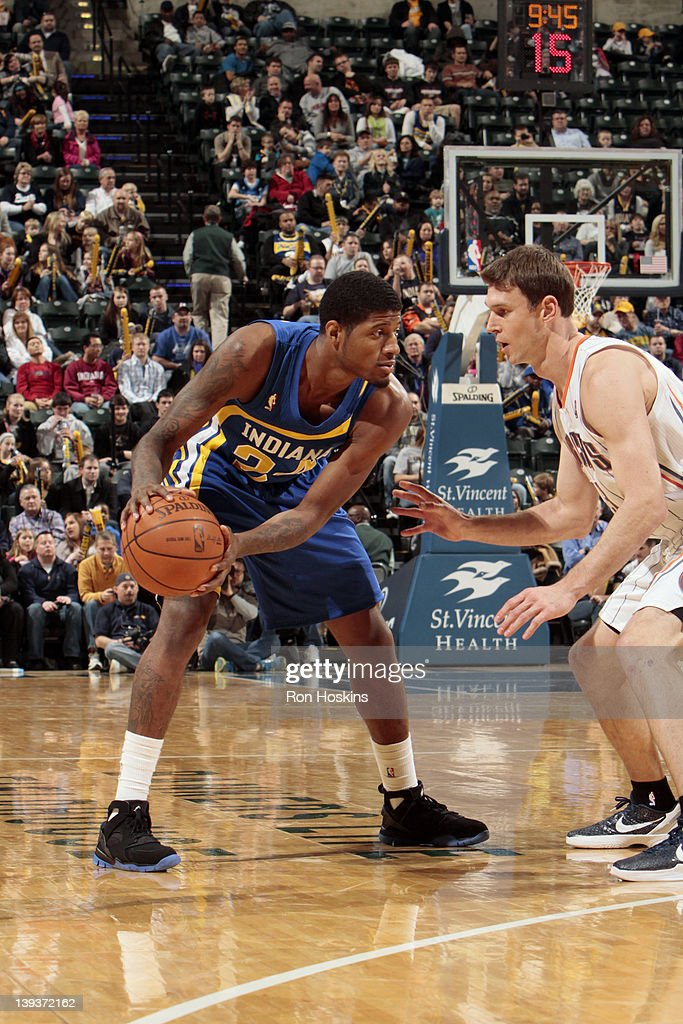 Paul George #24 of the Indiana Pacers controls the ball against <a gi-track='captionPersonalityLinkClicked' href=/galleries/search?phrase=Matt+Carroll+-+Jogador+de+basquetebol&family=editorial&specificpeople=213200 ng-click='$event.stopPropagation()'>Matt Carroll</a> #33 of the Charlotte Bobcats on February 19, 2012 at Bankers Life Fieldhouse in Indianapolis, Indiana.