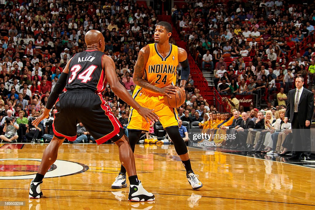 Paul George #24 of the Indiana Pacers controls the ball against <a gi-track='captionPersonalityLinkClicked' href=/galleries/search?phrase=Ray+Allen&family=editorial&specificpeople=201511 ng-click='$event.stopPropagation()'>Ray Allen</a> #34 of the Miami Heat on March 10, 2013 at American Airlines Arena in Miami, Florida.